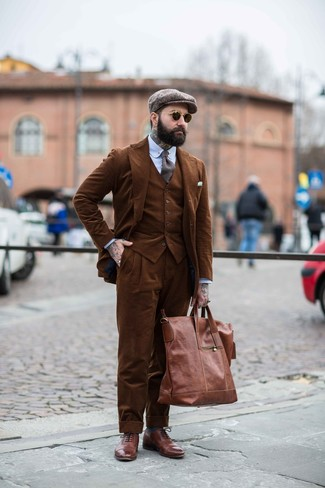 How to wear: brown leather tote bag, brown leather brogues, light blue vertical striped dress shirt, brown corduroy three piece suit