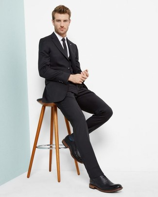 How to Wear a Black Three Piece Suit: Go for a sharp look in a black three piece suit and a white dress shirt. Let your outfit coordination sensibilities really shine by completing this ensemble with a pair of black leather brogues.