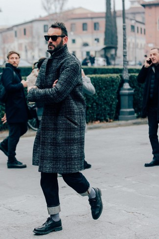 How to wear: black sunglasses, black leather brogues, navy jeans, charcoal plaid overcoat