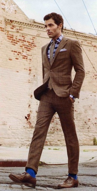How to wear: brown wool tie, brown leather brogues, navy and white plaid long sleeve shirt, brown check wool suit