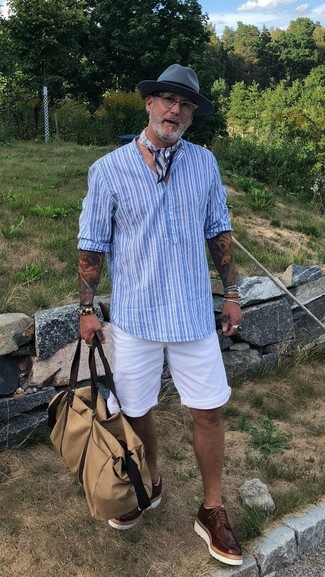 How to wear: beige canvas holdall, dark brown leather brogues, white shorts, light blue vertical striped henley shirt
