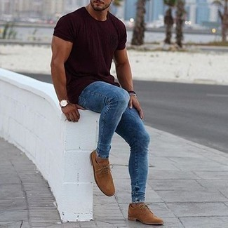 How to Wear Blue Skinny Jeans For Men: If you put practicality above all, this relaxed casual combination of a burgundy crew-neck t-shirt and blue skinny jeans is for you. To give your overall ensemble a more sophisticated aesthetic, complement your getup with tan suede brogues.