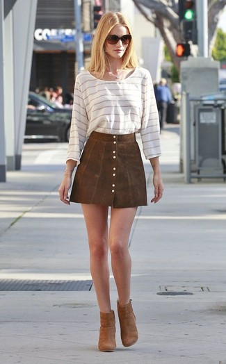 How to wear: dark brown sunglasses, brown suede ankle boots, brown suede button skirt, white horizontal striped long sleeve t-shirt