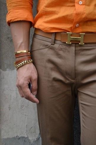 How to wear: brown leather bracelet, brown leather belt, brown dress pants, orange dress shirt