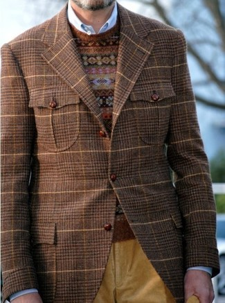 Try pairing a brown check suit jacket with mustard corduroy jeans for a refined yet off-duty ensemble. You can bet this look will become your uniform when cooler days are here.