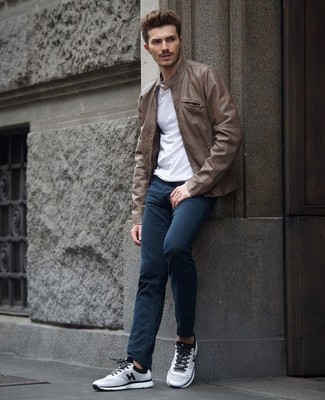 How to wear: brown leather bomber jacket, white crew-neck t-shirt, navy chinos, grey athletic shoes