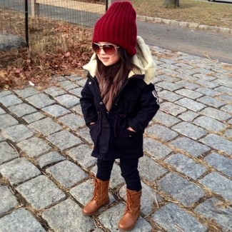How to wear: red beanie, brown boots, black leggings, black parka