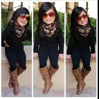 How to wear: brown boots, black leggings, black sweater