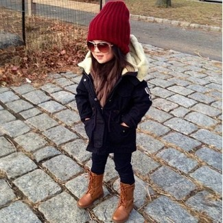 How to wear: red beanie, brown boots, black leggings, navy parka
