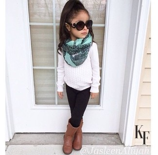 How to wear: mint scarf, brown boots, black leggings, white sweater