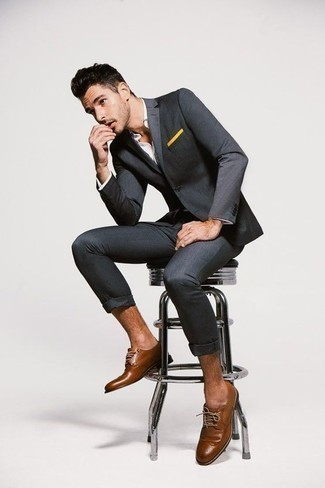 How To Wear a Suit With Brogues: You'll be surprised at how easy it is to get dressed this way. Just a suit and a white dress shirt. When this look looks too fancy, dress it down by slipping into a pair of brogues.