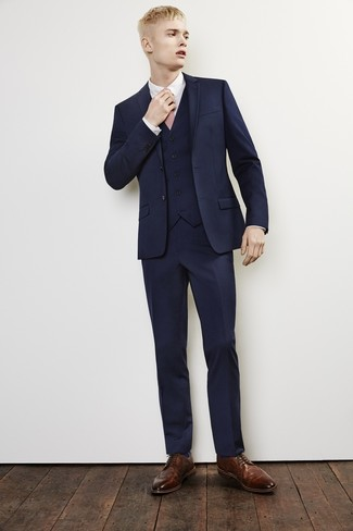 How to wear: pink tie, brown leather brogues, white dress shirt, navy three piece suit