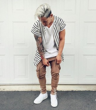 How to wear: white leather low top sneakers, brown cargo pants, white crew-neck t-shirt, white and black vertical striped short sleeve shirt