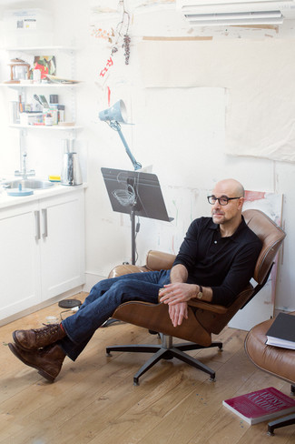 Stanley Tucci wearing Red Socks, Brown Leather Casual Boots, Navy Jeans, Black Polo Neck Sweater