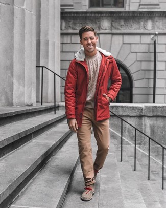 How to wear: brown suede desert boots, brown chinos, beige cable sweater, red parka
