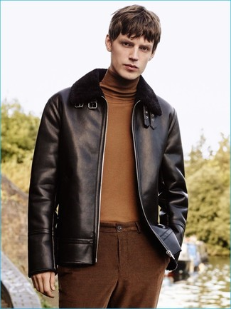 How to wear: brown chinos, brown turtleneck, black shearling jacket