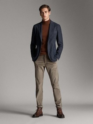 How to wear: brown leather casual boots, brown chinos, brown turtleneck, navy blazer