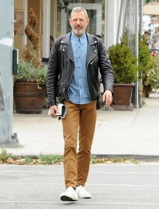 How to wear: white canvas low top sneakers, brown chinos, light blue chambray long sleeve shirt, black leather biker jacket