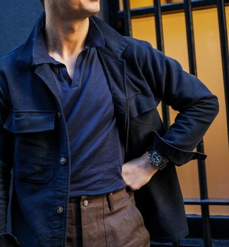 How to wear: black leather watch, brown chinos, navy polo, navy wool shirt jacket