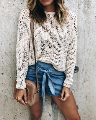 How to wear: gold pendant, brown leather crossbody bag, blue denim shorts, white crochet crew-neck sweater