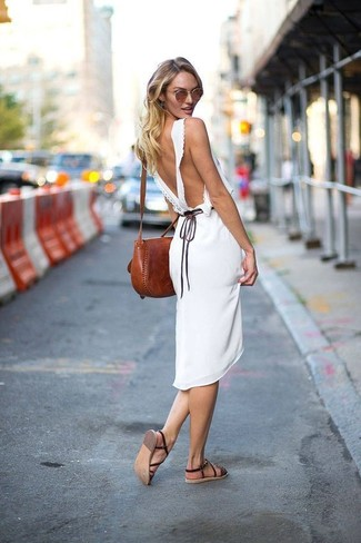 How to Wear Dark Brown Leather Flat Sandals: When the setting allows a casual getup, dress in a white midi dress. Balance this getup with more laid-back footwear, such as this pair of dark brown leather flat sandals.