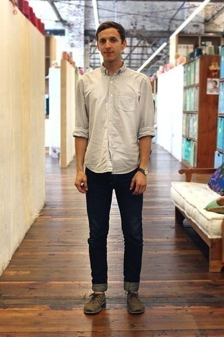 Men's Looks & Outfits: What To Wear Smart Casually: A beige long sleeve shirt and navy jeans are among those game-changing menswear staples that can reshape your closet. Feeling brave? Change things up a bit by wearing a pair of brown suede derby shoes.
