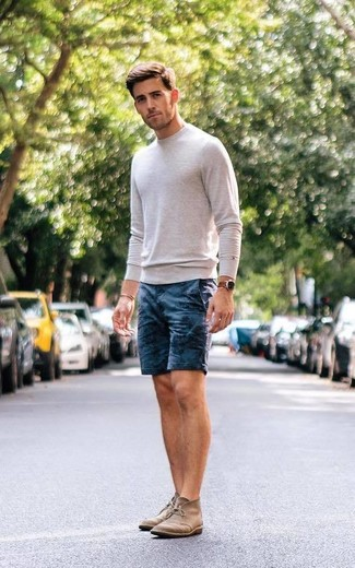 How to wear: brown leather watch, brown suede desert boots, navy print shorts, beige crew-neck sweater