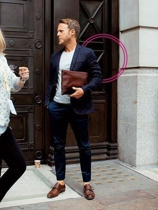 How to Wear Brown Leather Double Monks After 40: This pairing of a navy suit and a white crew-neck t-shirt is the perfect base for an outfit. Introduce brown leather double monks to the equation for a masculine aesthetic.