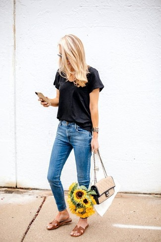 How to wear: tan leather satchel bag, brown leather flat sandals, blue skinny jeans, black v-neck t-shirt