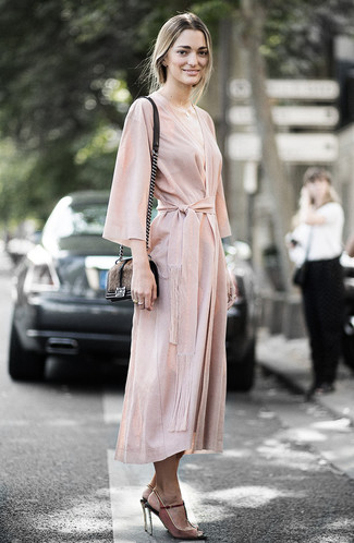 Women's Looks & Outfits: What To Wear In 2020: Rock a beige wrap dress to create an incredibly chic and put together outfit. A pair of brown suede heeled sandals is a smart option to complement this look.