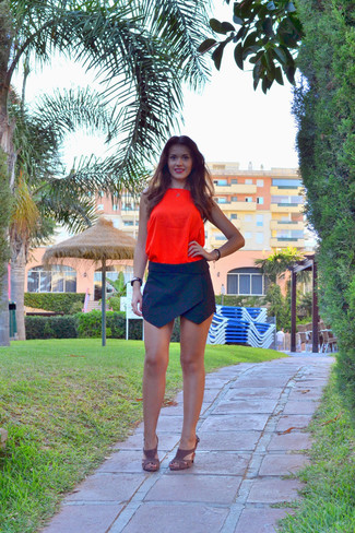 How to wear: black and gold watch, brown suede heeled sandals, black mini skirt, orange silk tank
