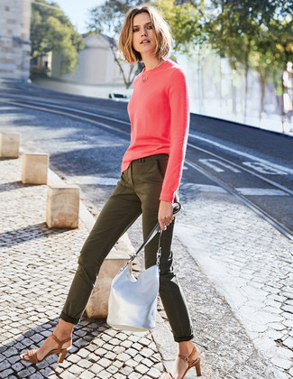 How to wear: silver leather bucket bag, brown leather heeled sandals, olive skinny jeans, hot pink crew-neck sweater