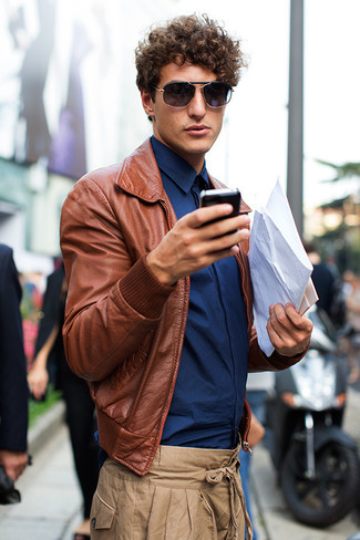 A brown leather bomber jacket with khaki chinos has become an essential combo for many style-conscious men. Seeing as temperatures are getting lower, this ensemble appears a good idea for the time in between seasons.