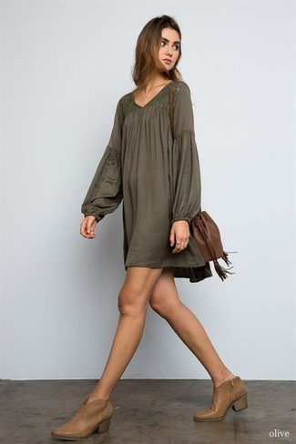 How to wear: brown leather bucket bag, brown leather ankle boots, olive peasant dress