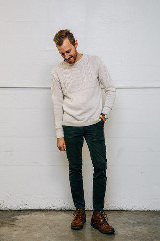 How to Wear Dark Green Corduroy Jeans For Men: Inject new life into your current off-duty collection with a beige cable sweater and dark green corduroy jeans. A pair of brown leather casual boots easily revs up the classy factor of this ensemble.
