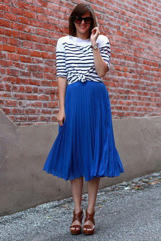 How to wear: brown leather heeled sandals, blue pleated midi skirt, white and black horizontal striped long sleeve t-shirt