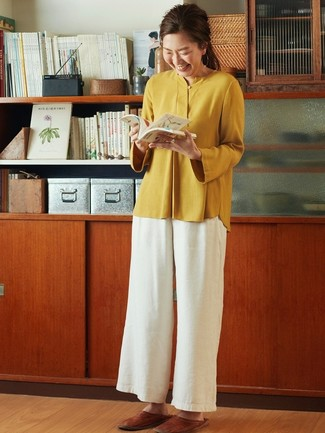 How to wear: brown leather loafers, white wide leg pants, mustard long sleeve blouse