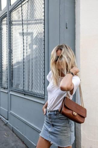 How to wear: brown leather satchel bag, light blue denim mini skirt, white crew-neck t-shirt