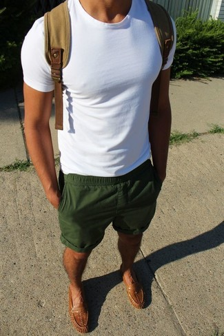 How to wear: tan canvas backpack, brown leather loafers, dark green shorts, white crew-neck t-shirt