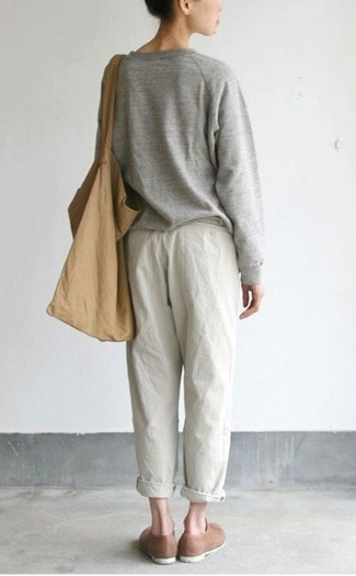 How to wear: tan canvas tote bag, brown suede loafers, white pajama pants, grey oversized sweater