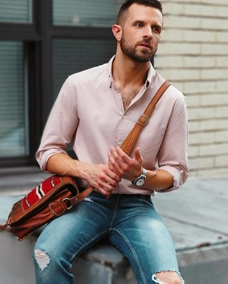 How to wear: silver watch, brown leather messenger bag, blue ripped skinny jeans, pink linen long sleeve shirt