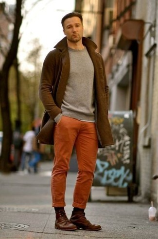 How to wear: brown overcoat, grey crew-neck sweater, orange chinos, brown leather casual boots