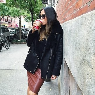 How to wear: black sunglasses, brown leather pencil skirt, black turtleneck, black shearling jacket