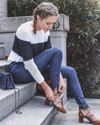 How to wear: navy leather crossbody bag, brown suede pumps, navy skinny jeans, white and navy horizontal striped crew-neck sweater