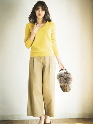 How to wear: tan straw handbag, brown suede pumps, tan wide leg pants, yellow v-neck sweater