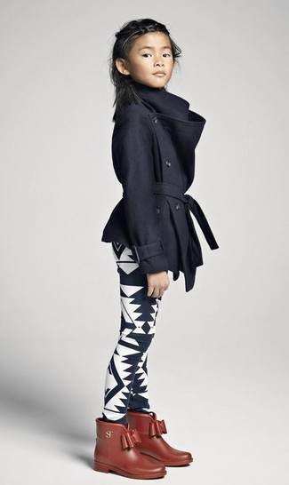 How to wear: brown rain boots, black and white print leggings, black coat