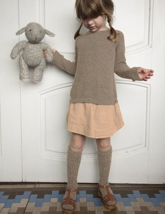 How to Wear Brown Sandals For Girls: Consider dressing your little angel in a brown sweater with a beige polka dot skirt to create a smart casual look. Round off this getup with brown sandals.