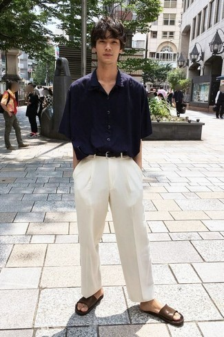 How to Wear a Navy Short Sleeve Shirt For Men: Such items as a navy short sleeve shirt and white chinos are the perfect way to inject some cool into your casual styling collection. Does this look feel too classic? Let a pair of brown leather sandals jazz things up.