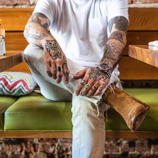 How to wear: brown suede cowboy boots, light blue jeans, white crew-neck t-shirt