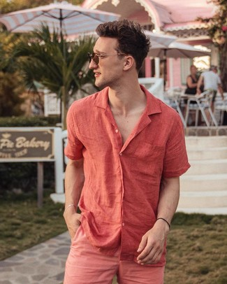How to wear: brown sunglasses, hot pink shorts, red linen short sleeve shirt